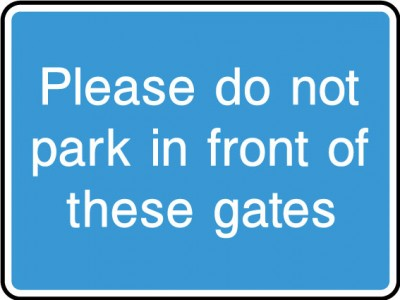 Do not park in front of gates sign