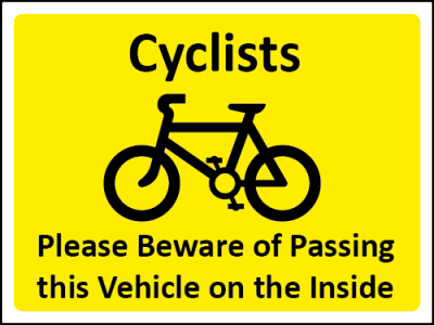 Cyclists, please beware of passing on the inside sign